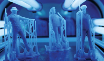soldier-figurines-being-cured-in-uv-chamber