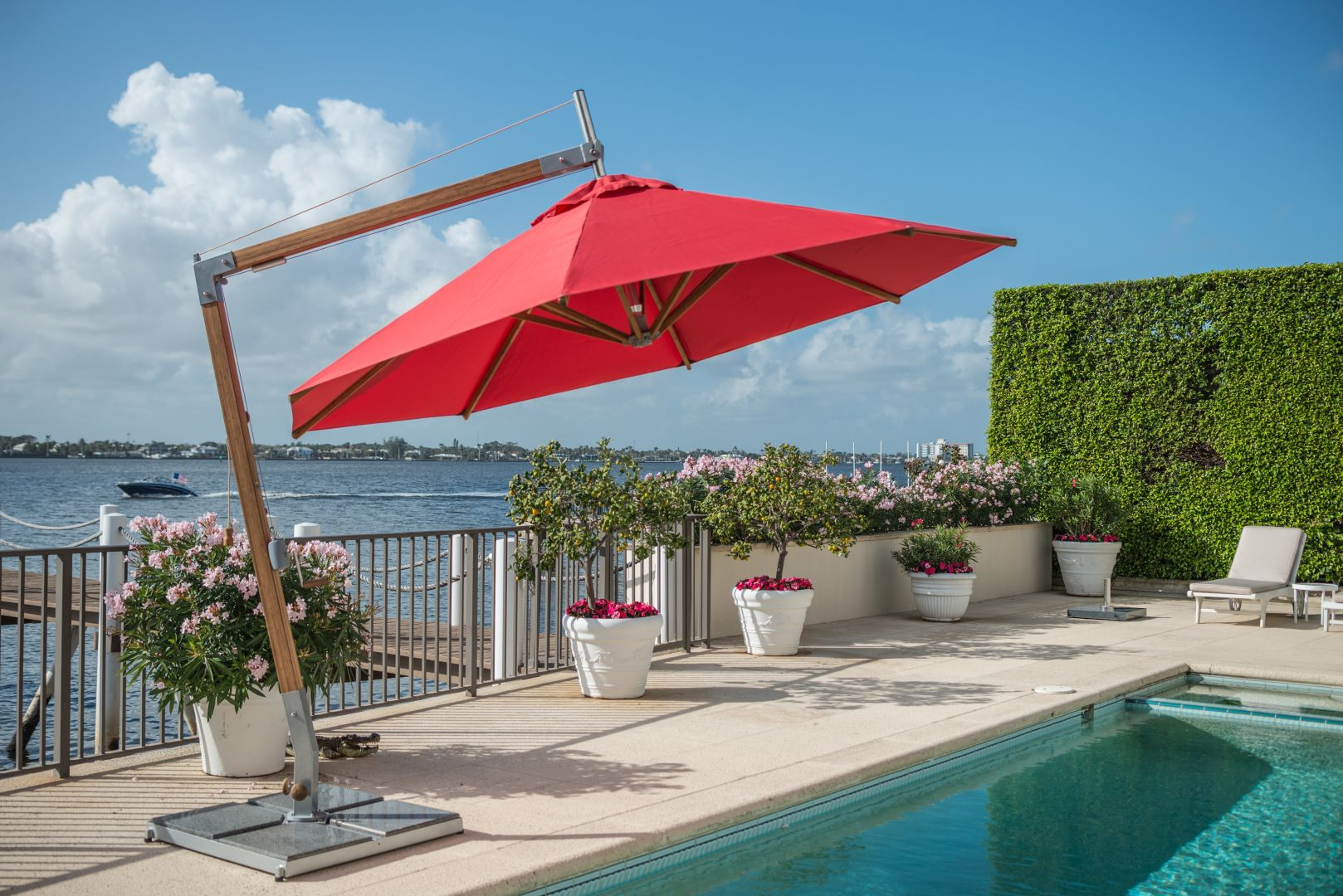red-hurricane-proof-umbrella-next-to-swimming-pool